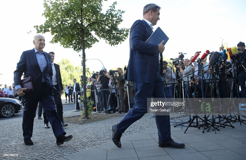 Markus Soeder (C), Governor of Bavaria and a leading member of the Bavarian Social Union (CSU), and Edmund Stoiber, former CSU leader, arrive shortly before Horst Seehofer, German Interior Minister and leader of the CSU, to meet with German Chancellor and leader of the German Chistian Democrats (CDU) Angela Merkel at CDU party headquarters on July 2, 2018 in Berlin, Germany. Seehofer had announced he will resign yesterday from both posts over what he sees as insufficient policy by Merkel over asylum and migraiton policy. He then announced he will postpone his resignation in order to meet with Merkel later today.