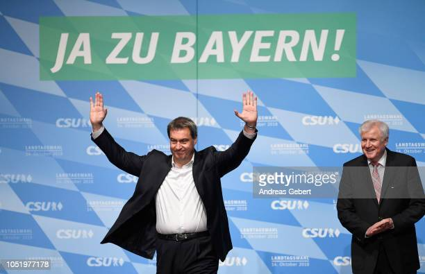 Markus Soeder Governor of Bavaria and lead candidate for the Bavarian Social Union stands next to Horst Seehofer leader of the CSU and waves to the...