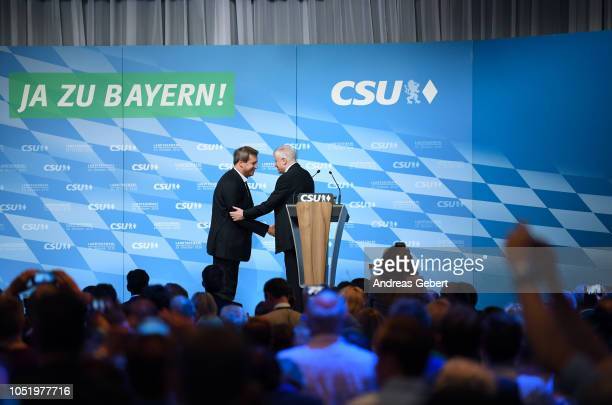 Markus Soeder Governor of Bavaria and lead candidate for the Bavarian Social Union and Horst Seehofer leader of the CSU shake hands after Soeder's...