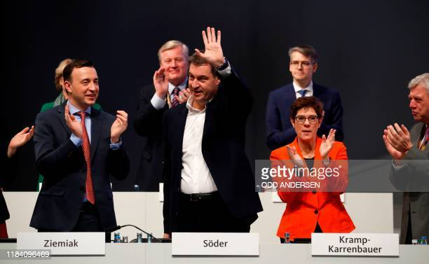 Markus Soeder , leader of the conservative Christian Social Union , is applauded by the leader of the Christian Democratic Union Annegret...