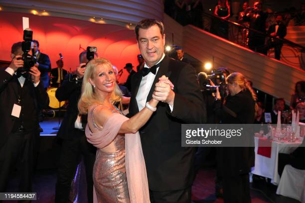 Markus Soeder, Prime Minister of Bavaria, and his wife Karin Soeder dance during the 47th German Film Ball party at Hotel Bayerischer Hof on January...