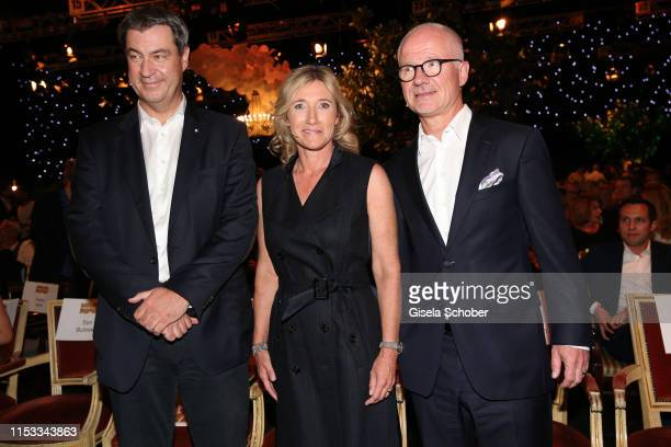 Markus Soeder Prime Minister of Bavaria Iris Ostermaier and Dr Christian Frankenstein during the Bavaria Film Reception One Hundred Years in Motion...
