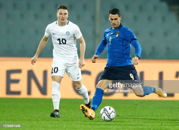Markus Soomets of Estonia and Kevin Lasagna of Italy battle for the ball during the International Friendly match between Italy and Estonia at Stadio...