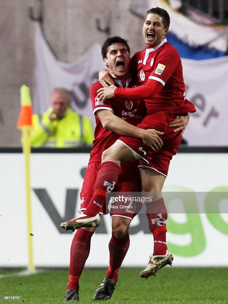 Markus Steinhoefer (R) of Kaiserslautern celebrates his team's first goal with team mate Florian Dick during the Second Bundesliga match between 1. FC Kaiserslautern and 1860 Muenchen at the Fritz-Walter Stadium on March 29, 2010 in Kaiserslautern, Germany.