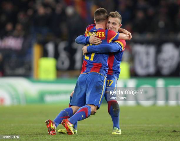 Markus Steinhofer and Xherdan Shaqiri of FC Basel celebrate after the UEFA Champions League Group C match between FC Basel and Manchester United at...