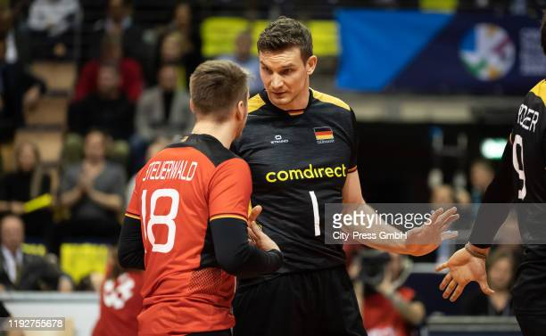 Markus Steuerwald and Christian Fromm of team Germany during the Volleyball European Qualification match between Bulgaria and Germany at...