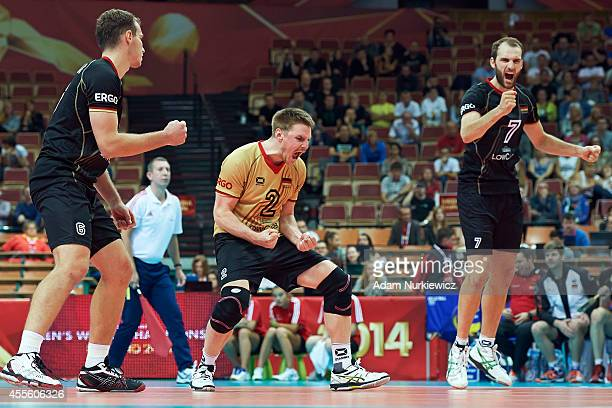 Markus Steuerwald of Germany celebrates winning the point with his teammates during the FIVB World Championships match between Germany and Iran at...