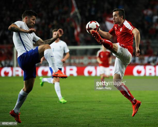 Markus Suttner of Austria is challenged by Joona Toivio of Finland during the Austria v Finland International Friendly match at Tivoli Stadium on...