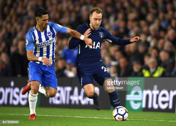 Markus Suttner of Brighton and Hove Albion battles for possesion with Christian Eriksen of Tottenham Hotspur during the Premier League match between...