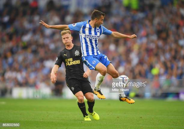 Markus Suttner of Brighton and Hove Albion beats Matt Ritchie of Newcastle United to the ball during the Premier League match between Brighton and...