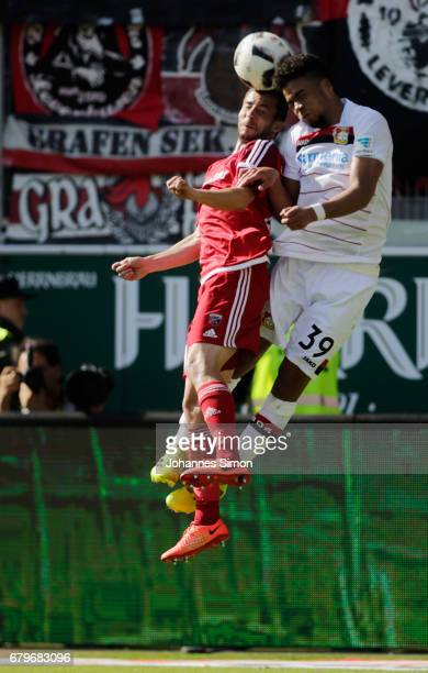 Markus Suttner of Ingolstadt and Benjamin Henrichs of Leverkusen fight for the ball during the Bundesliga match between FC Ingolstadt 04 and Bayer 04...