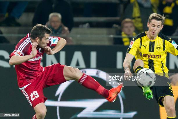 Markus Suttner of Ingolstadt and Erik Durm of Dortmund battle for the ball during the Bundesliga match between Borussia Dortmund and FC Ingolstadt 04...
