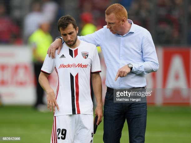 Markus Suttner of Ingolstadt and head coach Maik Walpurgis of Ingolstadt show their disappointment after the Bundesliga match between SC Freiburg and...