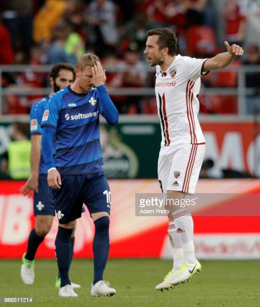 Markus Suttner of Ingolstadt celebrates his team's third goal as Jan Rosenthal of Darmstadt reactsduring the Bundesliga match between FC Ingolstadt...