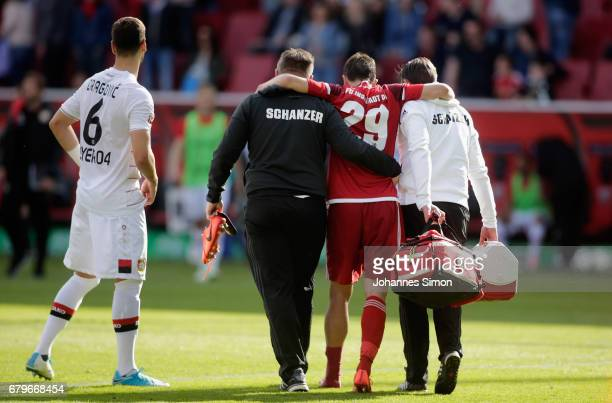 Markus Suttner of Ingolstadt leaves the pitch hurt after the Bundesliga match between FC Ingolstadt 04 and Bayer 04 Leverkusen at Audi Sportpark on...