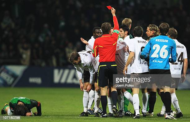 Markus Thorandt gets the red card from refferee Felix Brych during the Bundesliga match between SV Werder Bremen and FC St Pauli at Weser Stadium on...