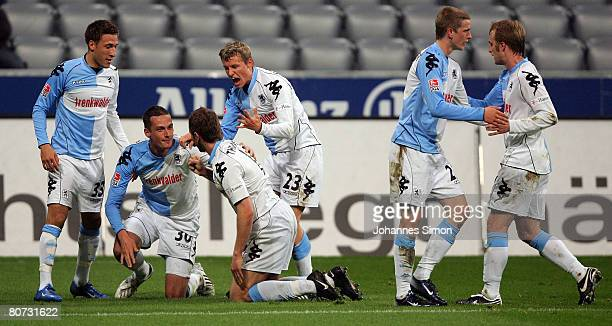Markus Thorandt of Munich celebrates with his teammates Fabian Johnson Lukasz Szukala Benjamin Schwarz Lars Bender and Daniel Bierofka after scoring...