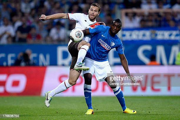Markus Thorandt of St Pauli and Richard Sukuta Pasu of VfL Bochum battle for the ball during the Second Bundesliga match between VfL Bochum and FC St...