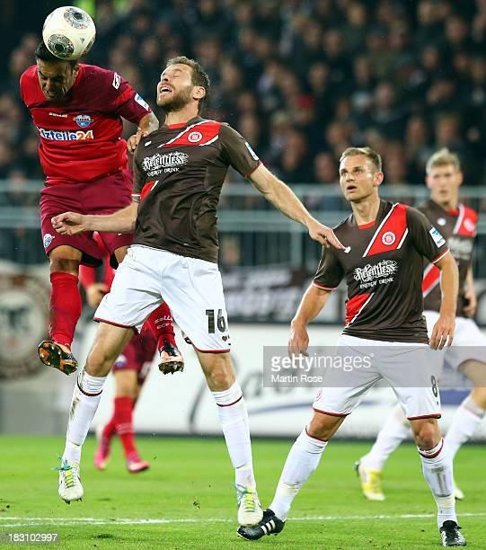 Markus Thorandt of StPauli and Mahir Saglik of Paderborn battles for the ball during the Second Bundesliga match between FC St Pauli and SC Paderborn...