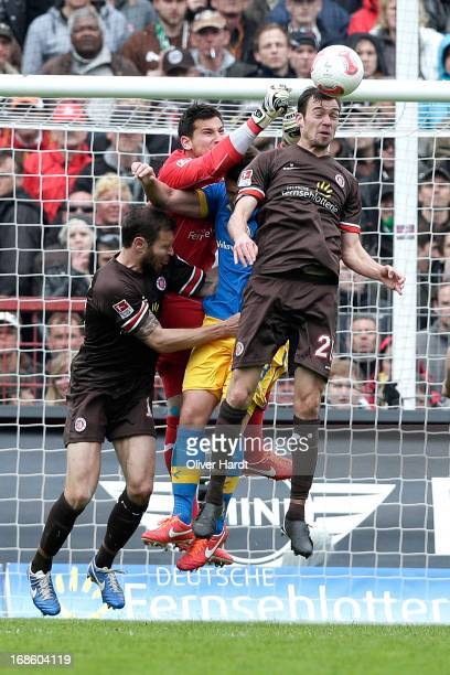 Markus Thorandt Philipp Tschauner Sebastian Schachten of Pauli and Orhan Ademi of Braunschweig battle for the ball during the Second Bundesliga match...