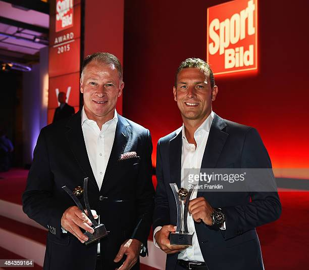 Markus Weinzierl and Stefan Reuter of Augsburg hold their awards at the Sport Bild Awards 2015 on August 17 2015 in Hamburg Germany