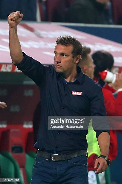 Markus Weinzierl head coach of Augsburg celebrates his teams second goal during the Bundesliga match between FC Augsburg and Borussia...