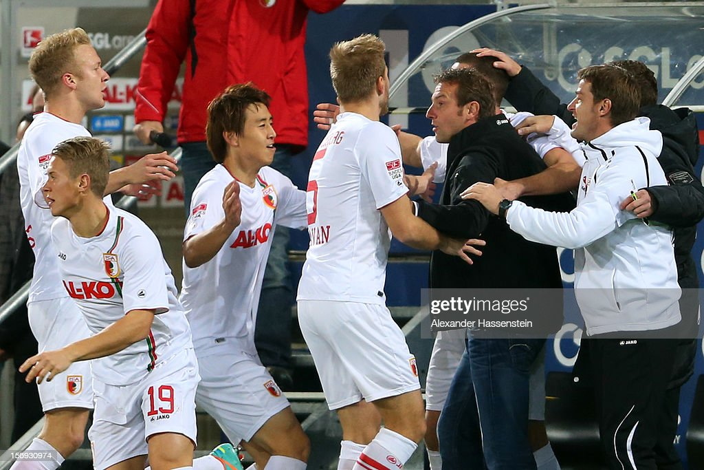 Markus Weinzierl (2nd R), head coach of Augsburg celebrates the first team goal with his players during the Bundesliga match between FC Augsburg and VfL Borussia Moenchengladbach at SGL Arena on November 25, 2012 in Augsburg, Germany.