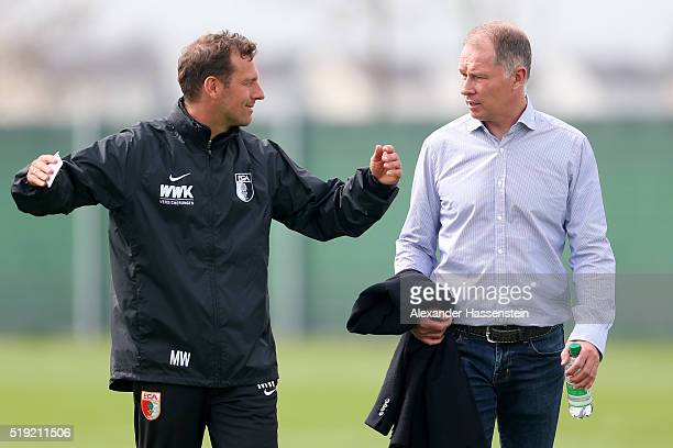 Markus Weinzierl head coach of Augsburg talks to Stefan Reuter Sporting director of Augsburg after a FC Augsburg Training session at WWK Arena on...