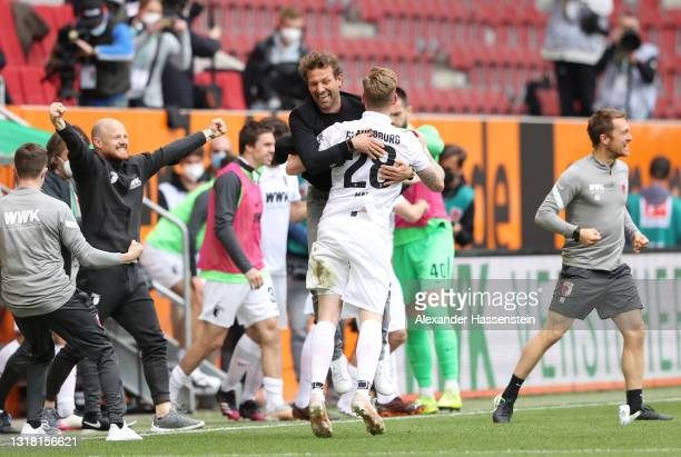 Markus Weinzierl, Head Coach of FC Augsburg celebrates victory with Andre Hahn of FC Augsburg following the Bundesliga match between FC Augsburg and...