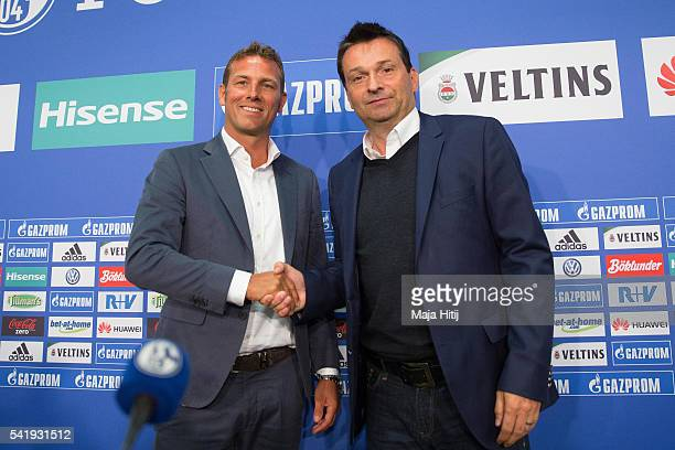 Markus Weinzierl , the newly appointed head coach of FC Schalke 04 and Schalke's manager Christian Heidel pose prior a press conference at Veltins...