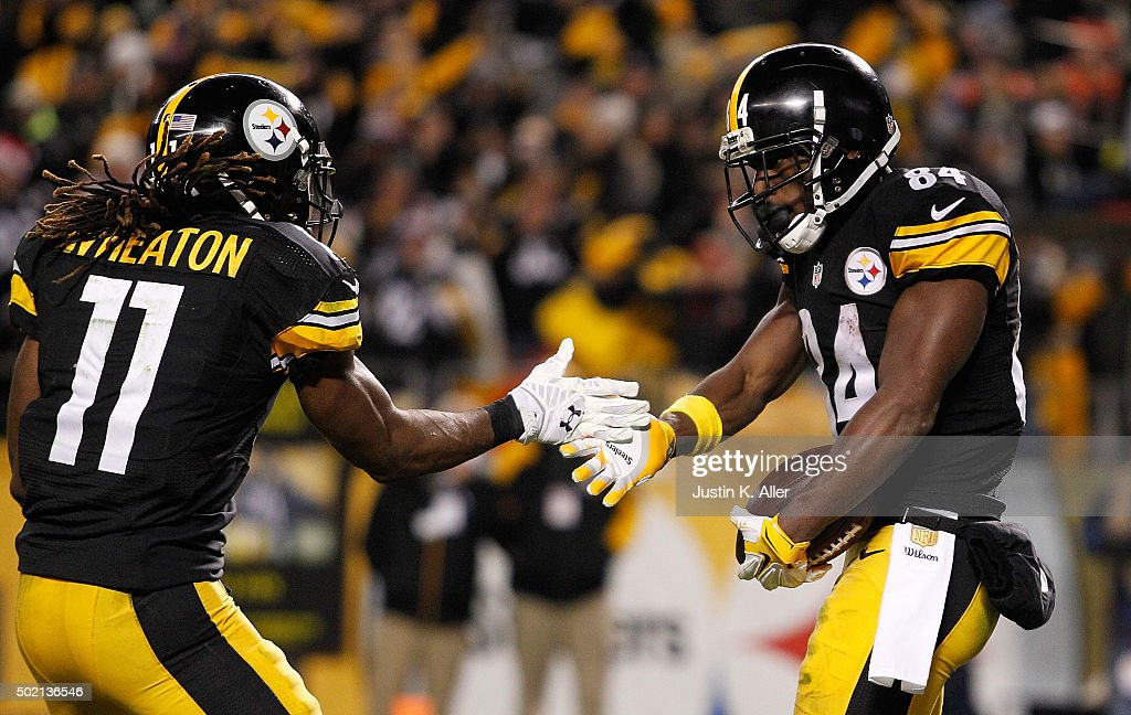 Markus Wheaton #11 of the Pittsburgh Steelers and Antonio Brown #84 of the Pittsburgh Steelers celebrate Brown's fourth quarter touchdown during the game against the Denver Broncos at Heinz Field on December 20, 2015 in Pittsburgh, Pennsylvania.