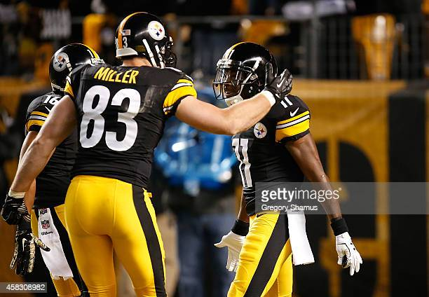 Markus Wheaton of the Pittsburgh Steelers celebrates his touchdown with Heath Miller during the second quarter against the Baltimore Ravens at Heinz...