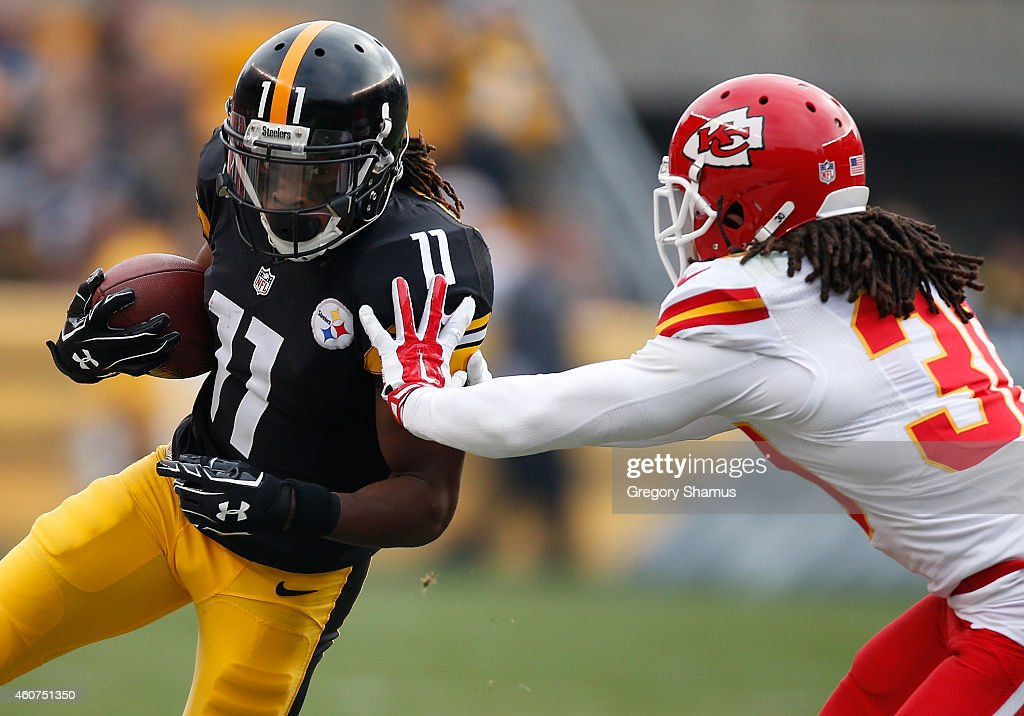 Markus Wheaton #11 of the Pittsburgh Steelers gets pushed out of bounds by Jamell Fleming #30 of the Kansas City Chiefs during the second quarter at Heinz Field on December 21, 2014 in Pittsburgh, Pennsylvania.
