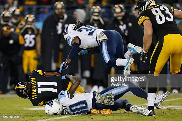 Markus Wheaton of the Pittsburgh Steelers is tackled by Jason McCourty and Daimion Stafford of the Tennessee Titans in the fourth quarter at LP Field...