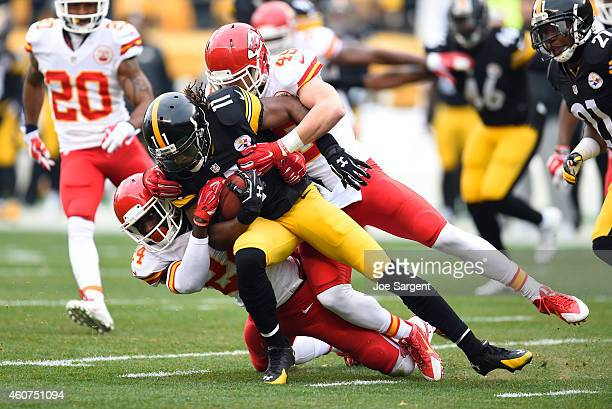 Markus Wheaton of the Pittsburgh Steelers is tackled by Kelcie McCray and Daniel Sorensen of the Kansas City Chiefs during the first quarter at Heinz...