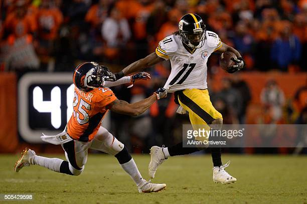 Markus Wheaton of the Pittsburgh Steelers stiff arms Chris Harris of the Denver Broncos for the first down The Denver Broncos played the Pittsburgh...