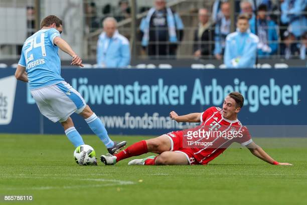 Markus Ziereis of 1860 Muenchen and Adrian Fein of Bayern Muenchen battle for the ball during the match between TSV 1860 Muenchen and Bayern Muenchen...