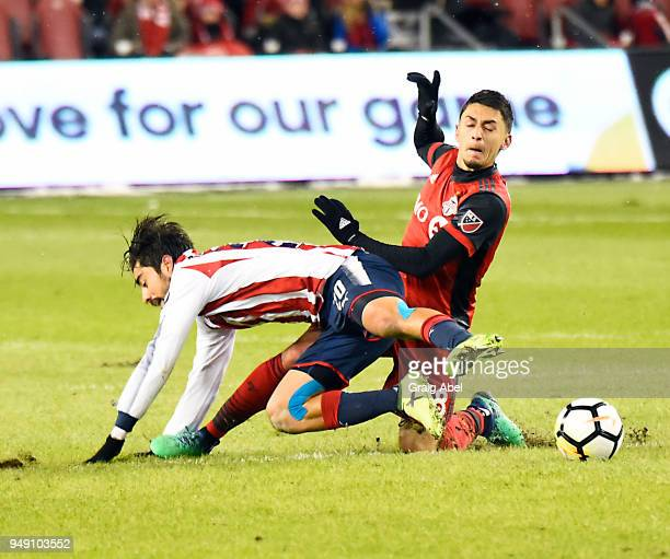Marky Delgado of Toronto FC battles for the ball with Rodolfo Pizarro of Chivas Guadalajara during the CONCACAF Champions League Final Leg 1 on April...