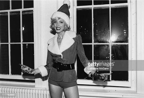 Marla Maples dressed as Santa Claus backstage at DIFFA benefit fashion show in December 1996 in New York City New York United States