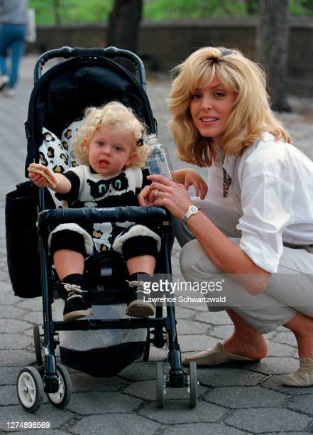 Marla Maples, then wife of Donald Trump, and daughter, Tiffany Trump in stroller on Fifth Avenue after a stroll in Central Park, NYC. Exclusive.
