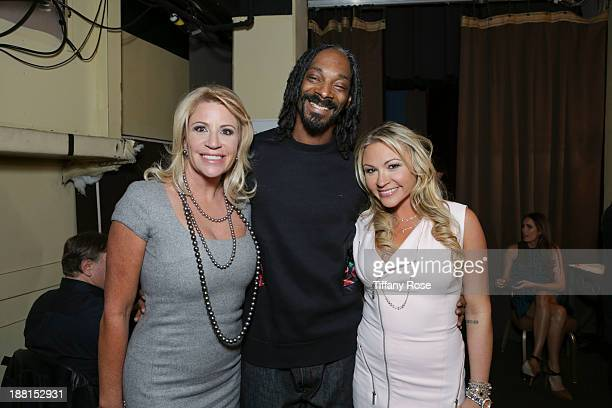 Marla Nicole Paxson and Snoop Lion attend the Hollywood Bag Ladies Luncheon on November 15 2013 in Beverly Hills California