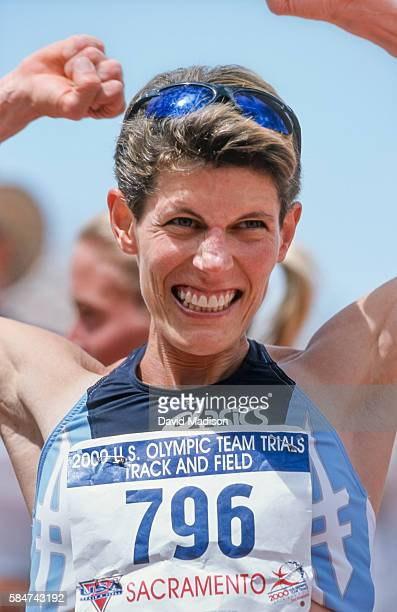 Marla Runyan of the USA celebrates her third place finish in the Women's 1500 meter race of the USA Track and Field Olympic Trials held at Hornet...