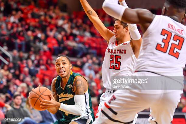 Marlain Veal of the Southeastern Louisiana Lions goes to the basket against Davide Moretti of the Texas Tech Red Raiders during the game on November...