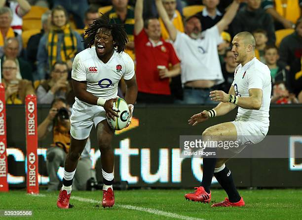 Marland Yarde of England celebrates with team mate Mike Brown after scoring their second try during the International Test match between the...