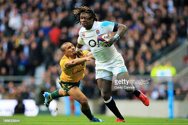 Marland Yarde of England evades a tackle from Will Genia of Australia during the QBE International match between England and Australia at Twickenham...