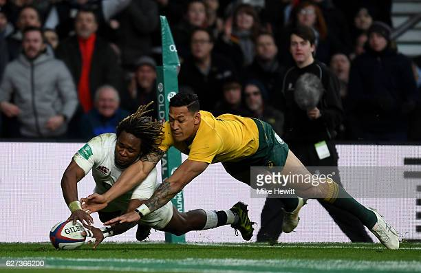 Marland Yarde of England scores his sides second try while Israel Folau of Australia attempts to stop him during the Old Mutual Wealth Series match...