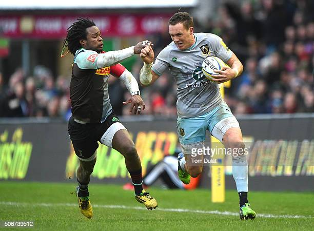 Marland Yarde of Harlequins and James Wilson of Northampton Saints in action during the Aviva Premiership match between Harlequins and Northampton...