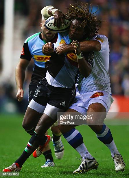 Marland Yarde of Harlequins attempst to escape a tackle during the European Rugby Champions Cup Pool 2 match between Harlequins and Castres Olympique...
