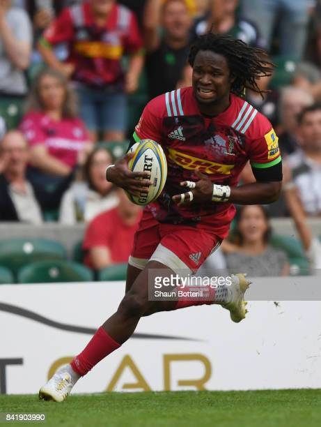 Marland Yarde of Harlequins breaks through to score their second try during the Aviva Premiership match between London Irish and Harlequins at...