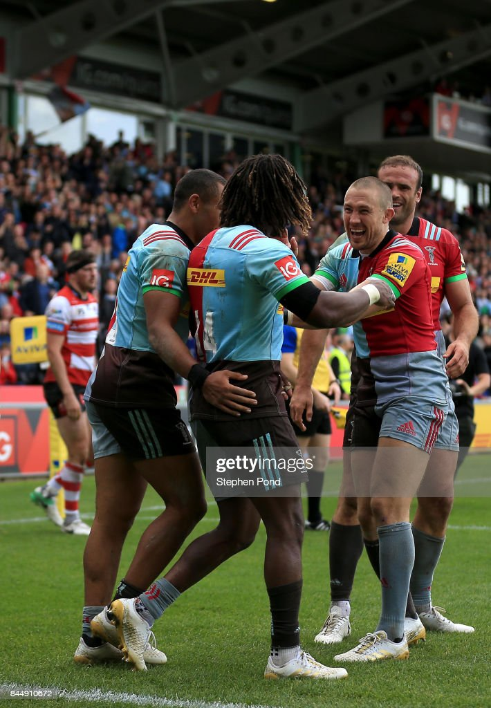 Marland Yarde of Harlequins celebrates a try with team mates during the Aviva Premiership match between Harlequins and Gloucester Rugby at Twickenham Stoop on September 9, 2017 in London, England.
